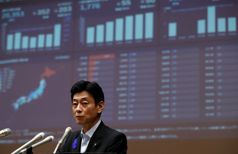Japan's Economy Minister Yasutoshi Nishimura attends a joint news conference with Tokyo Governor Yuriko Koike in Tokyo