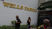 EARNINGS: Wells Fargo stock sinks after reporting big profits miss