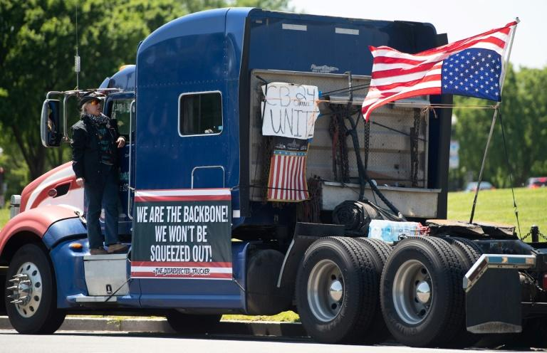 A protesting trucker parked on the National Mall outside the White House