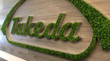 Takeda sees surprise full-year operating profit on post-merger savings