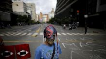Venezuela leader's foes levy new sanctions and fresh strike
