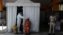 India's coronavirus death toll passes 100,000 with no sign of an end