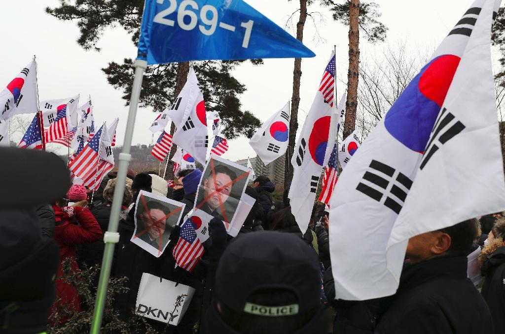 South Korean protesters hold pictures of North Korean leader Kim Jong Un during an anti-North Korea rally in Seoul (AFP Photo/-)