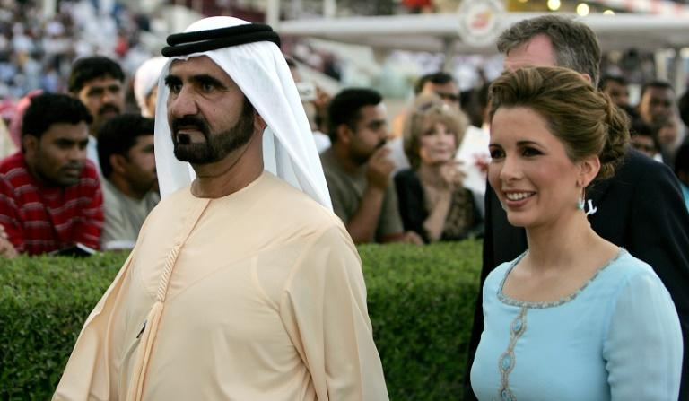 Sheikh Mohammed bin Rashed al-Maktum (C) and his wife Princess Haya (R) are locked in a legal battle in the UK over the welfare of their children (AFP Photo/Karim SAHIB)