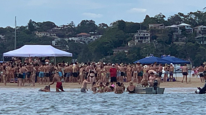Police bust beach party after photos of huge crowds emerge
