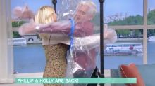 Holly Willoughby and Phillip Schofield use 'cuddle curtain' to hug for first time in six months