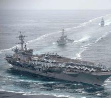 US Navy captain says carrier faces dire coronavirus threat