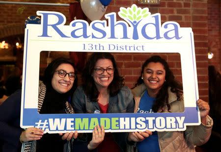 Democratic U.S. congressional candidate Rashida Tlaib (C) celebrates at her midterm election night party in Detroit, Michigan, U.S. November 6, 2018. REUTERS/Rebecca Cook