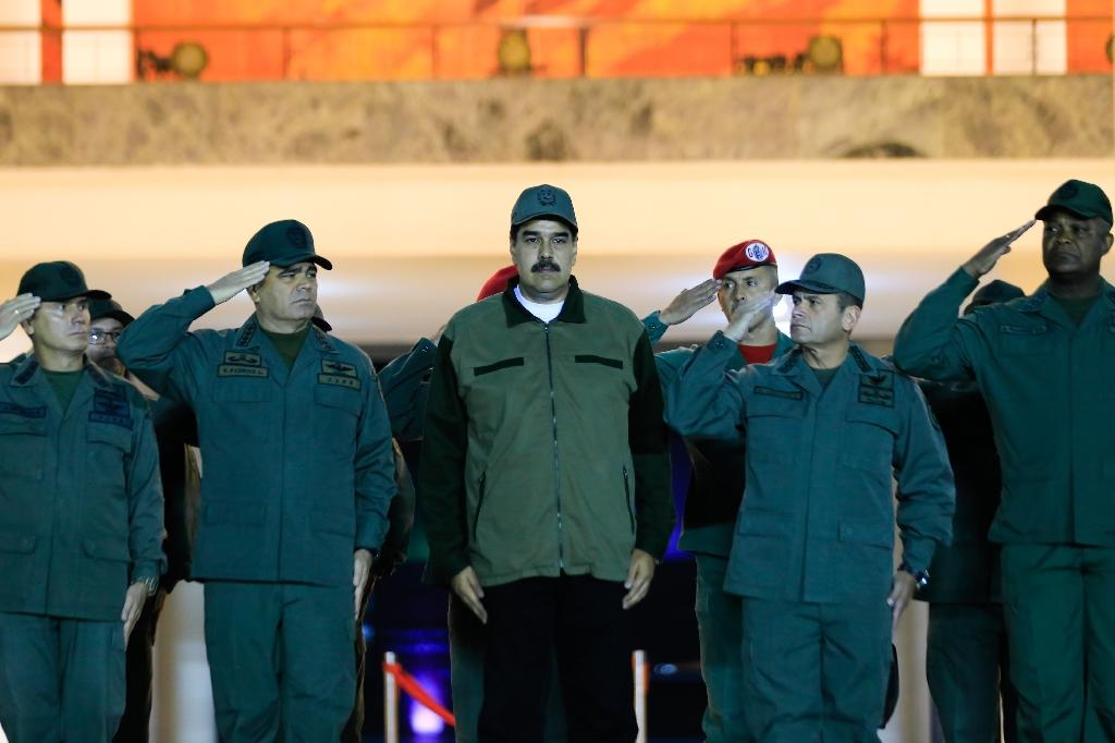Venezuela's President Nicolas Maduro receives a salute from troops, after an uprising by troops loyal to opposition leader Juan Guaido fizzled out (AFP Photo/HO)