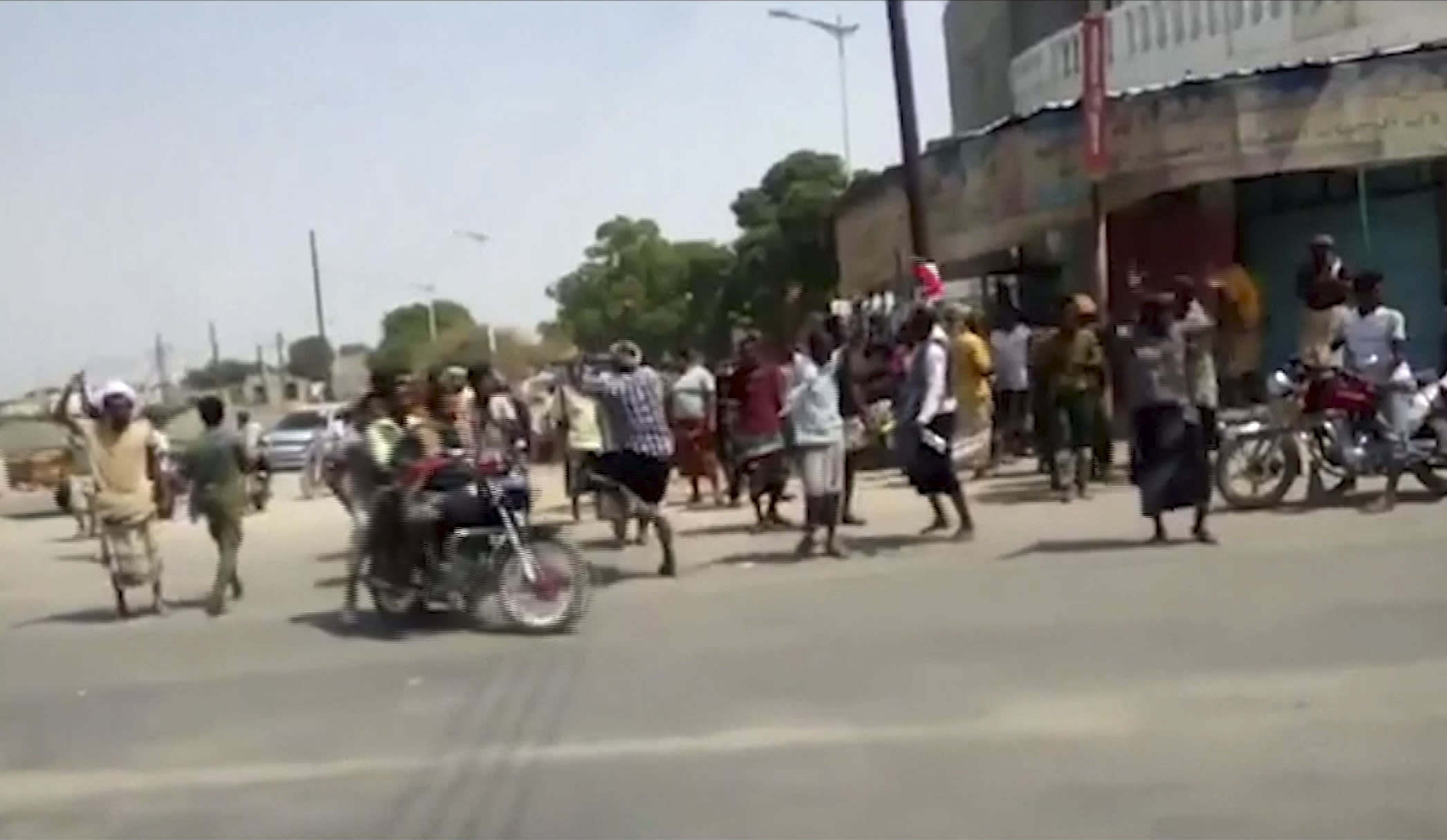 In this frame grab from video provided by Yemen Today, residents cheered and chanted as Yemeni army vehicles entered Zinjibar, Yemen, Wednesday, Aug. 28, 2019. Yemeni officials and local residents say forces loyal to the country's internationally recognized government have wrested control of the capital of southern Abyan province from separatists backed by the United Arab Emirates. They say government forces on Wednesday pushed the UAE-backed militia, known as the Security Belt, out of Zinjibar after clasher that left at least one dead and 30 wounded fighters. (Yemen Today via AP)
