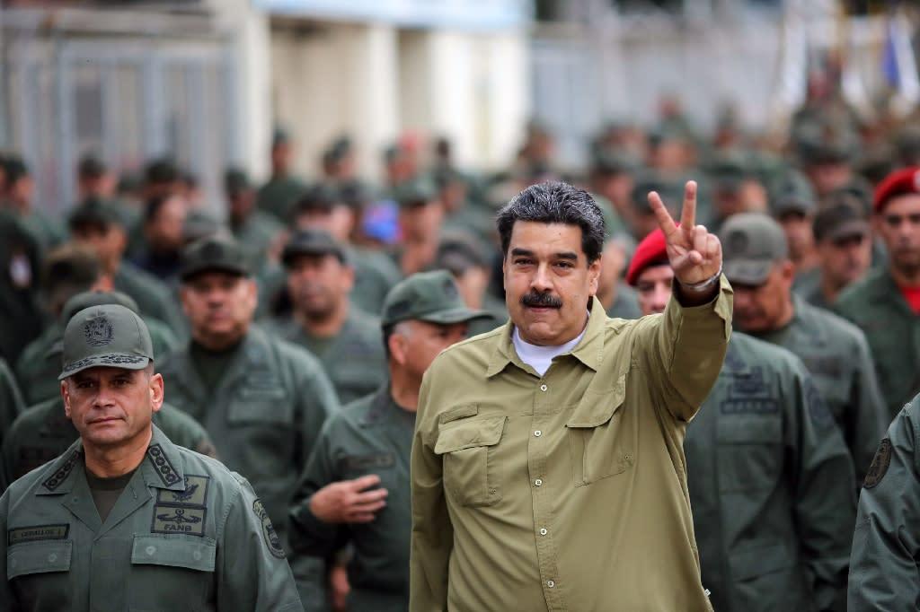 The United States is leading a push to topple Venezuelan President Nicolas Maduro (R) (AFP Photo/Marcelo GARCIA)