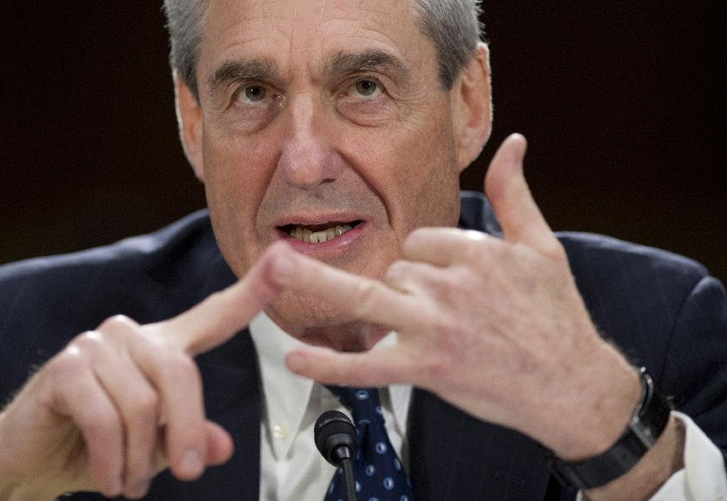 The indictment of 12 Russian military intelligence officers for interfering in the 2016 presidential election was brought by Special Counsel Robert Mueller, the former FBI director (AFP Photo/Saul LOEB)