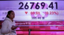 World stocks rise but Britain slips on Brexit limbo