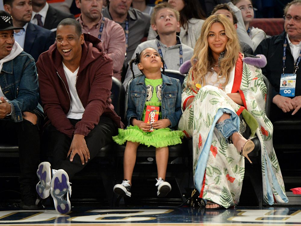 Beyoncé, left, pictured with daughter Blue Ivy and husband Jay-Z