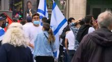Montreal police use tear-gas to disperse clashing pro-Israeli, pro-Palestinian protesters