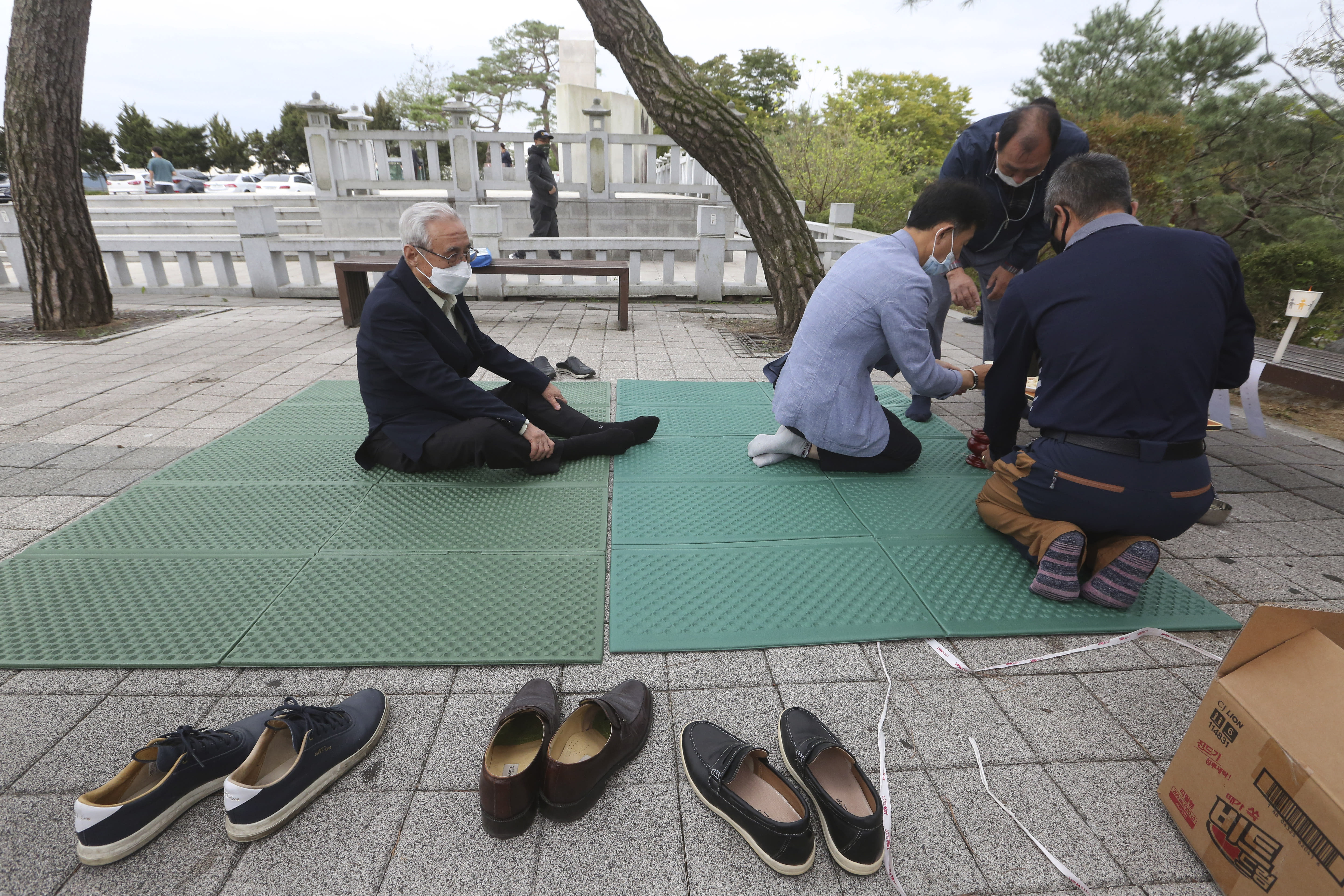 North Korean refugee Jo Kyeong-hyeon, left, and his family members pay respect to their ancestors in North Korea to celebrate the Chuseok, the Korean version of Thanksgiving Day, at Imjingak Pavilion in Paju, near the border with North Korea, South Korea, Thursday, Oct. 1, 2020. The government has discouraged people from visiting their hometowns for the Chuseok holiday amid concerns about the spread of the coronavirus. (AP Photo/Ahn Young-joon)