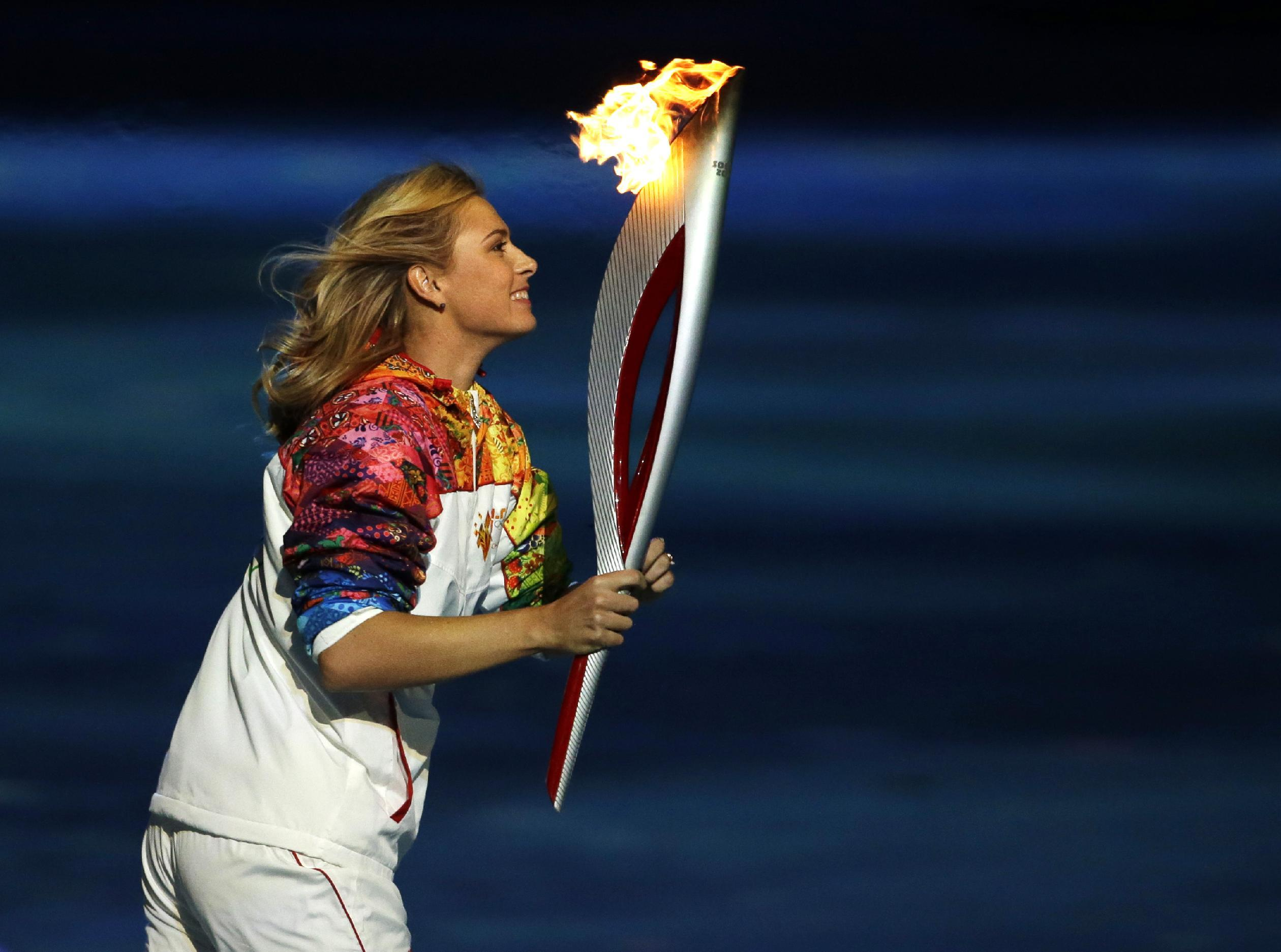 Irina Rodnina and Vladislav Tretyak lit the Olympic flame in Sochi 70