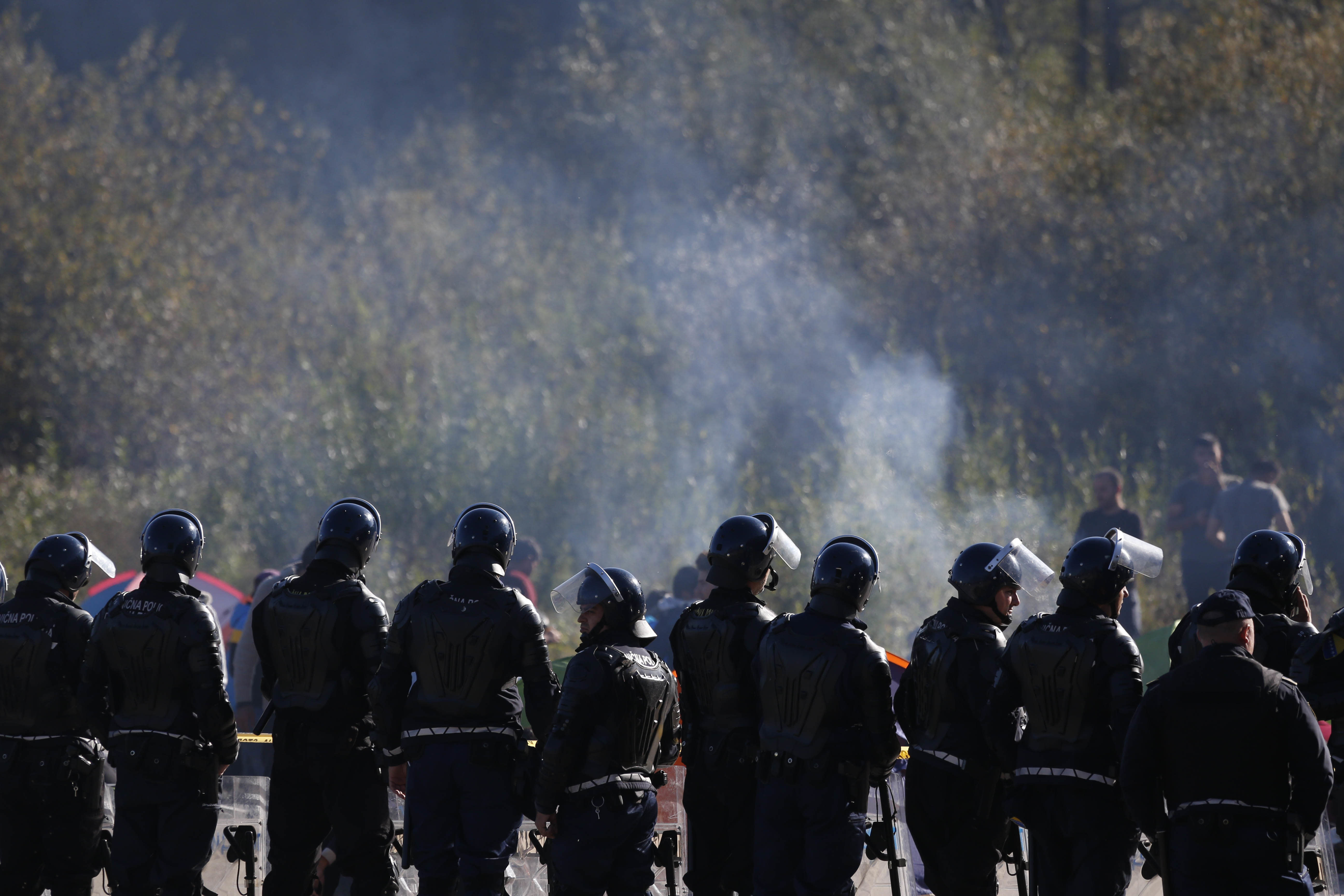 Bosnian police forces secure a road in Maljevac, Bosnia, near to the border with Croatia, Thursday, Oct. 25, 2018. Bosnian police say three officers and three migrants have been hurt in skirmishes on the border with Croatia where dozens of people have been trying to cross into the European Union country.(AP Photo/Amel Emric)