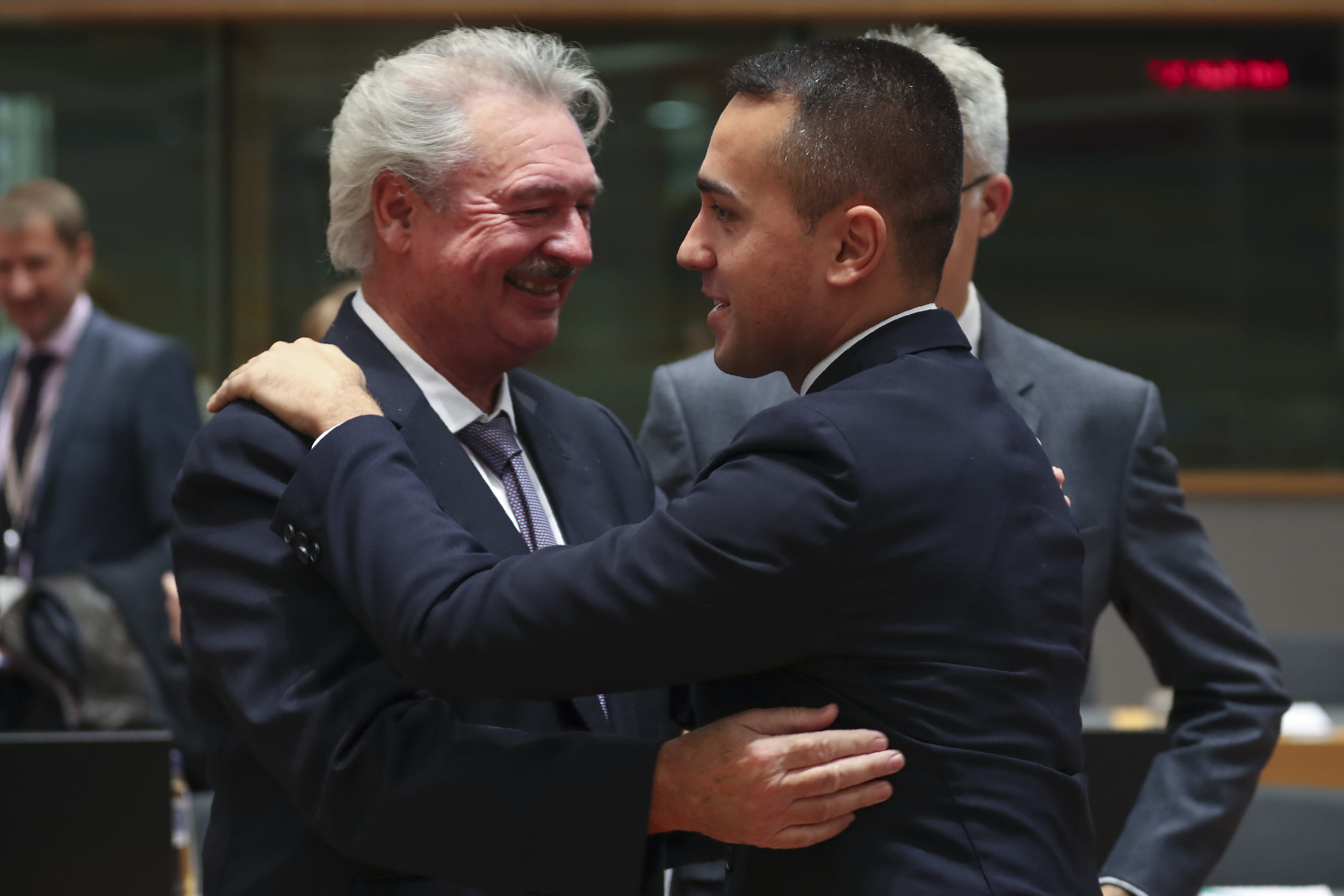 Italian Foreign Minister Luigi Di Maio, right, greets his Luxembourg counterpart Jean Asselborn an European Foreign Affairs Ministers meeting at the Europa building in Brussels, Monday, Nov. 11, 2019. European Union foreign ministers on Monday debated ways to keep the Iran nuclear deal intact after the Islamic Republic began enrichment work at its Fordo site in a fresh act of defiance that seems likely to spell the end of the painstakingly drafted international agreement. (AP Photo/Francisco Seco)