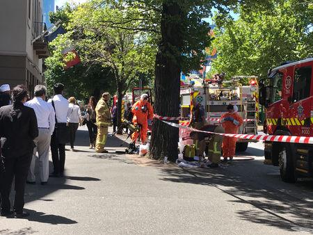 Hazmat and fire crews are seen outside the Indian and French Consulates on St Kilda Road in Melbourne