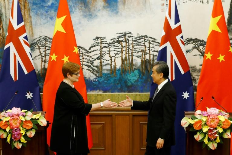 Beijing and Canberra have also sparred over access to natural resources, maritime claims and the use of Chinese state-backed technology companies (AFP Photo/THOMAS PETER)