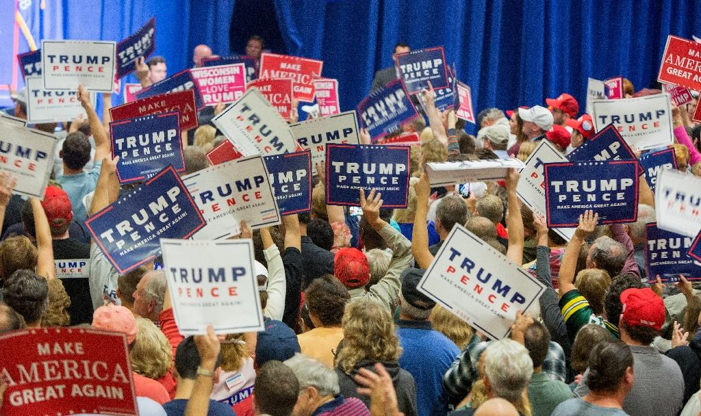 At a rally in Wisconsin, a Donald Trump voter said he is concerned about whether supporters will accept the election result if Hillary Clinton wins (AFP Photo/Tasos Katopodis)