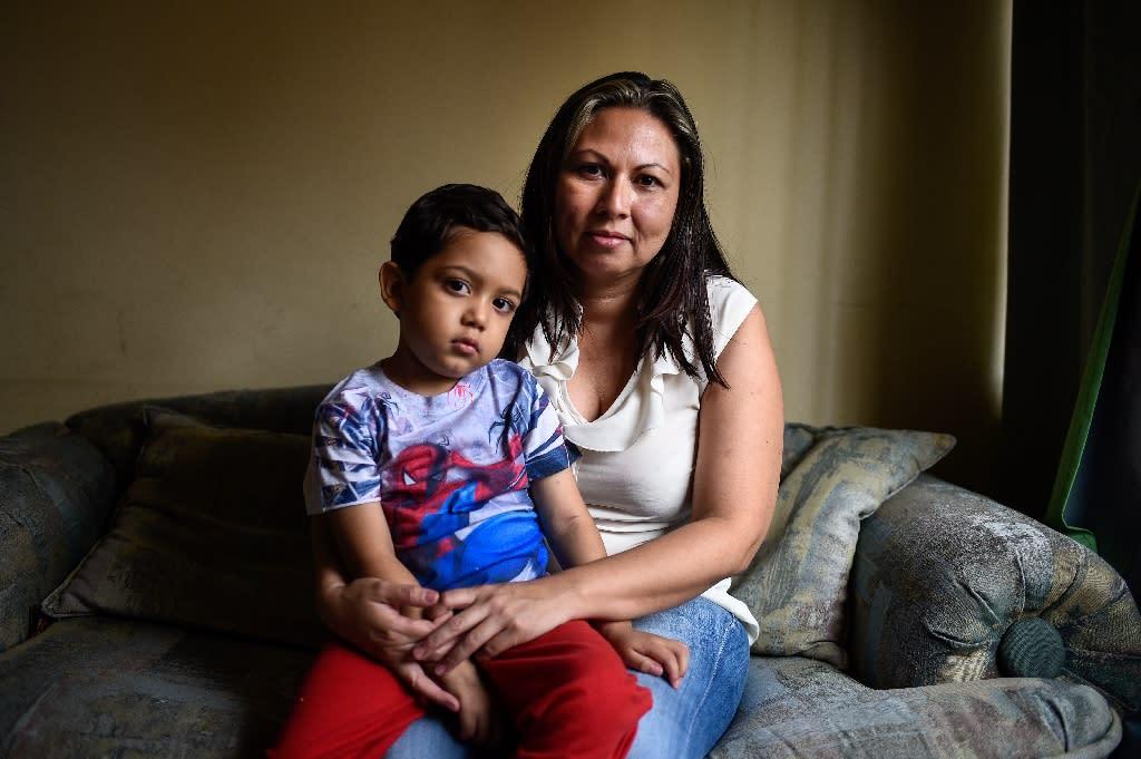 Ani Camacho with her five-year-old son Zabdiel, who needs a bone-marrow transplant (AFP Photo/Federico PARRA)