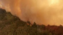 California battles its biggest ever wildfire, Trump vows support