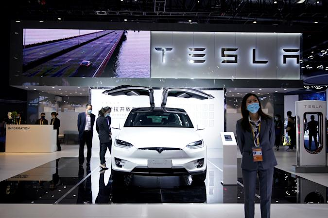 Tesla sign is seen at the third China International Import Expo (CIIE) in Shanghai, China November 5, 2020. REUTERS/Aly Song