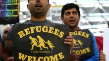 German asylum numbers fall, but still too high, minister says