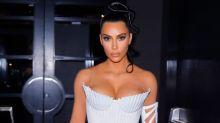 Kim Kardashian mocked for 'missing the memo' as she braves minus temperatures in revealing mini dress