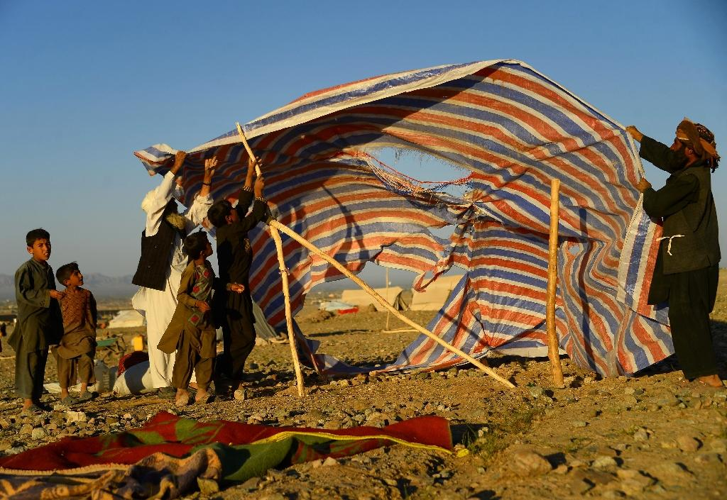 Conditions are miserable in the camps that have mushroomed across the unforgiving landscape in recent months as above-average temperatures and intense fighting forced more people to abandon their villages and livelihoods (AFP Photo/HOSHANG HASHIMI)
