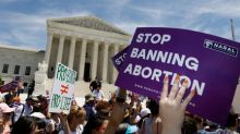 U.S. abortion rights activists blast new state bans in Supreme Court rally