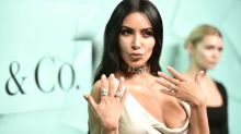 Kim Kardashian goes braless in a Grecian goddess dress