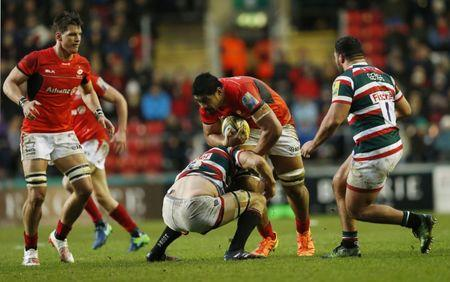 Saracens' Will Skelton in action with Leicester's Michael Fitzgerald