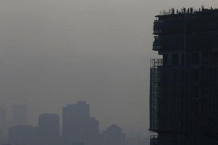 Builders at work on hazy day in Kuala Lumpur