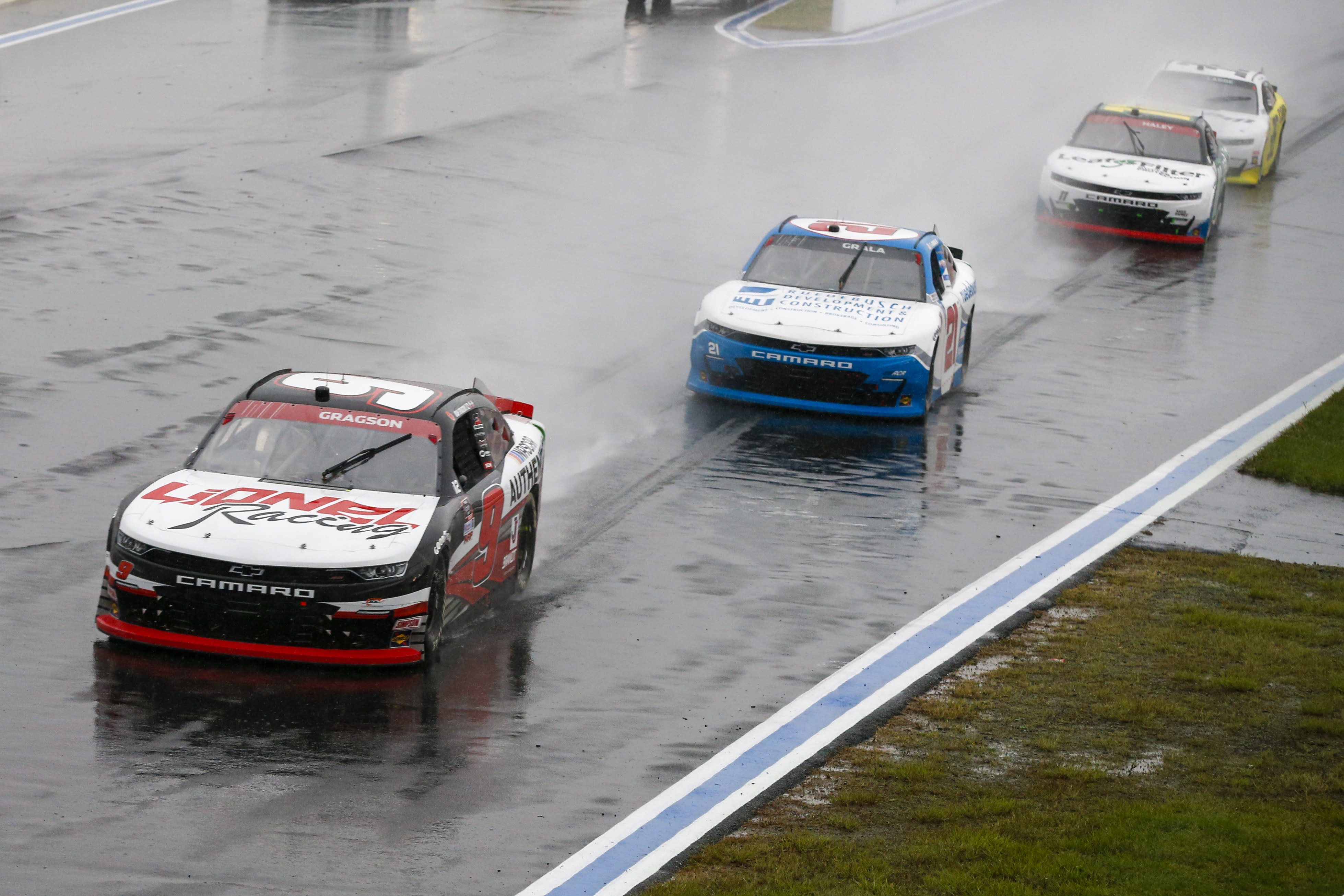 Noah Gragson (9) leads the way as drivers compete in the rain during a NASCAR Xfinity Series auto race at Charlotte Motor Speedway in Concord, N.C., Saturday, Oct. 10, 2020. (AP Photo/Nell Redmond)