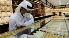 Gold eases as equities rally; Hong Kong woes limit losses