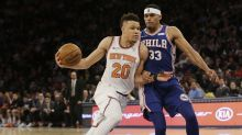 Knicks rookie Kevin Knox's monstrous two-handed dunk sends Ben Simmons flying