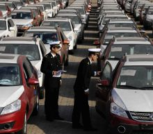 U.S. launches auto import probe, China says will defend interests