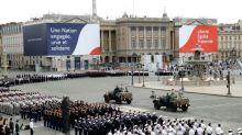 Macron hosts downsized Bastille Day, to outline crisis response plans