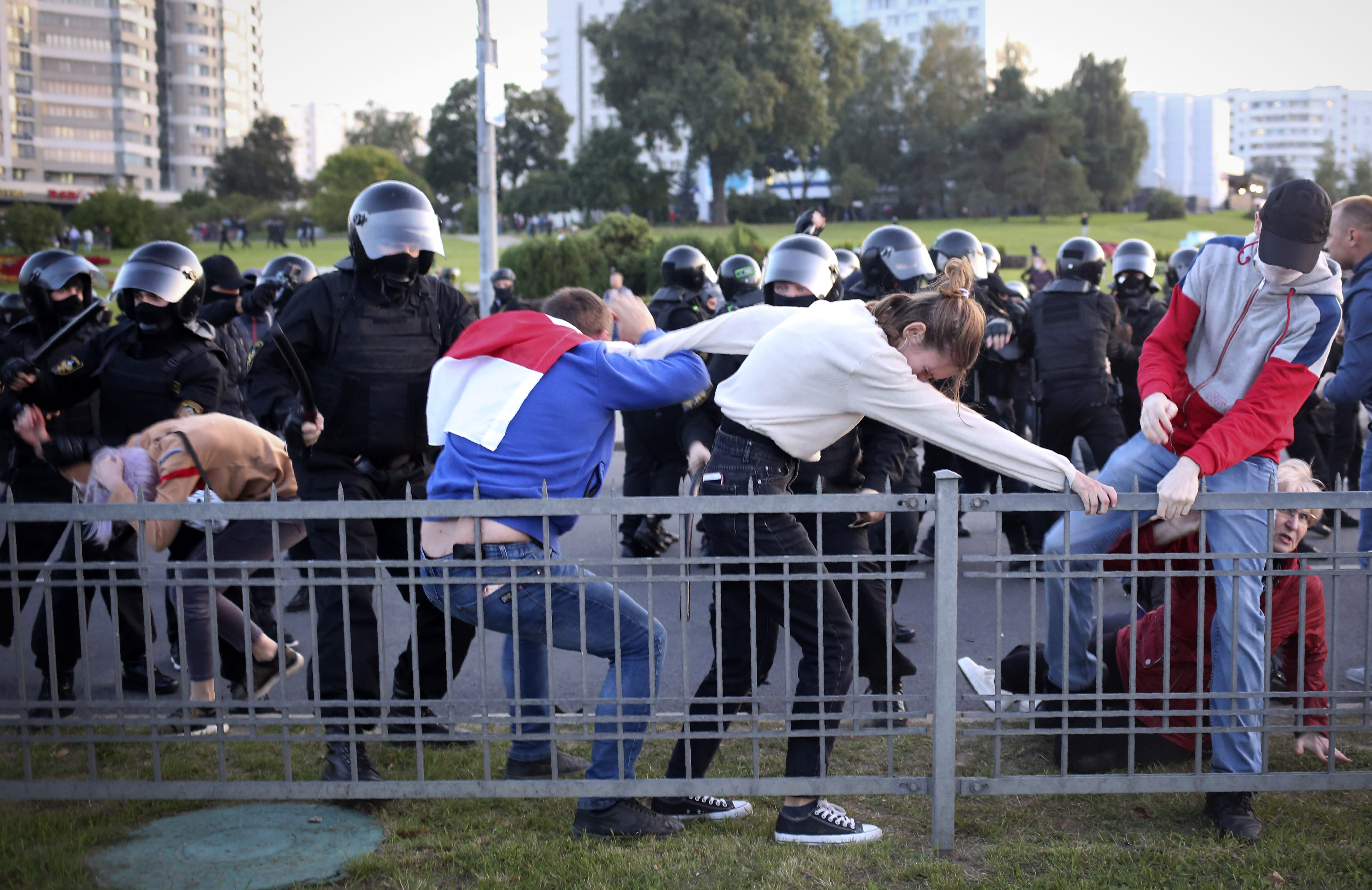 Riot police detain protesters during an opposition rally to protest the presidential inauguration in Minsk, Belarus, Wednesday, Sept. 23, 2020. Belarus President Alexander Lukashenko has been sworn in to his sixth term in office at an inaugural ceremony that was not announced in advance amid weeks of huge protests saying the authoritarian leader's reelection was rigged. Hundreds took to the streets in several cities in the evening to protest the inauguration. (AP Photo/TUT.by)