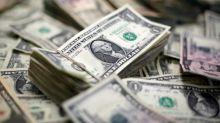 Dollar scales 11-month peak, oil slides ahead of OPEC