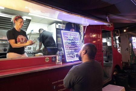 A man orders food at a food truck in San Juan, Puerto Rico, November 3, 2016. REUTERS/Alvin Baez