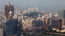 Macau, Beijing police arrest 37 in crackdown on illicit banking