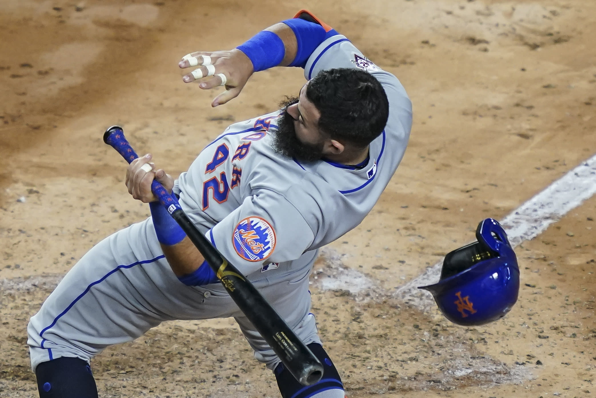 New York Mets' Luis Guillorme loses his helmet as he dodges a pitch from New York Yankees relief pitcher Nick Nelson in the fifth inning of the second baseball game of a doubleheader, Friday, Aug. 28, 2020, in New York. (AP Photo/John Minchillo)