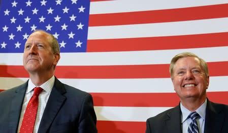 North Carolina's 9th District Republican candidate Dan Bishop and South Carolina Senator Lindsay Graham listen as U.S. President Donald Trump speaks during a campaign rally in Fayetteville, North Carolina