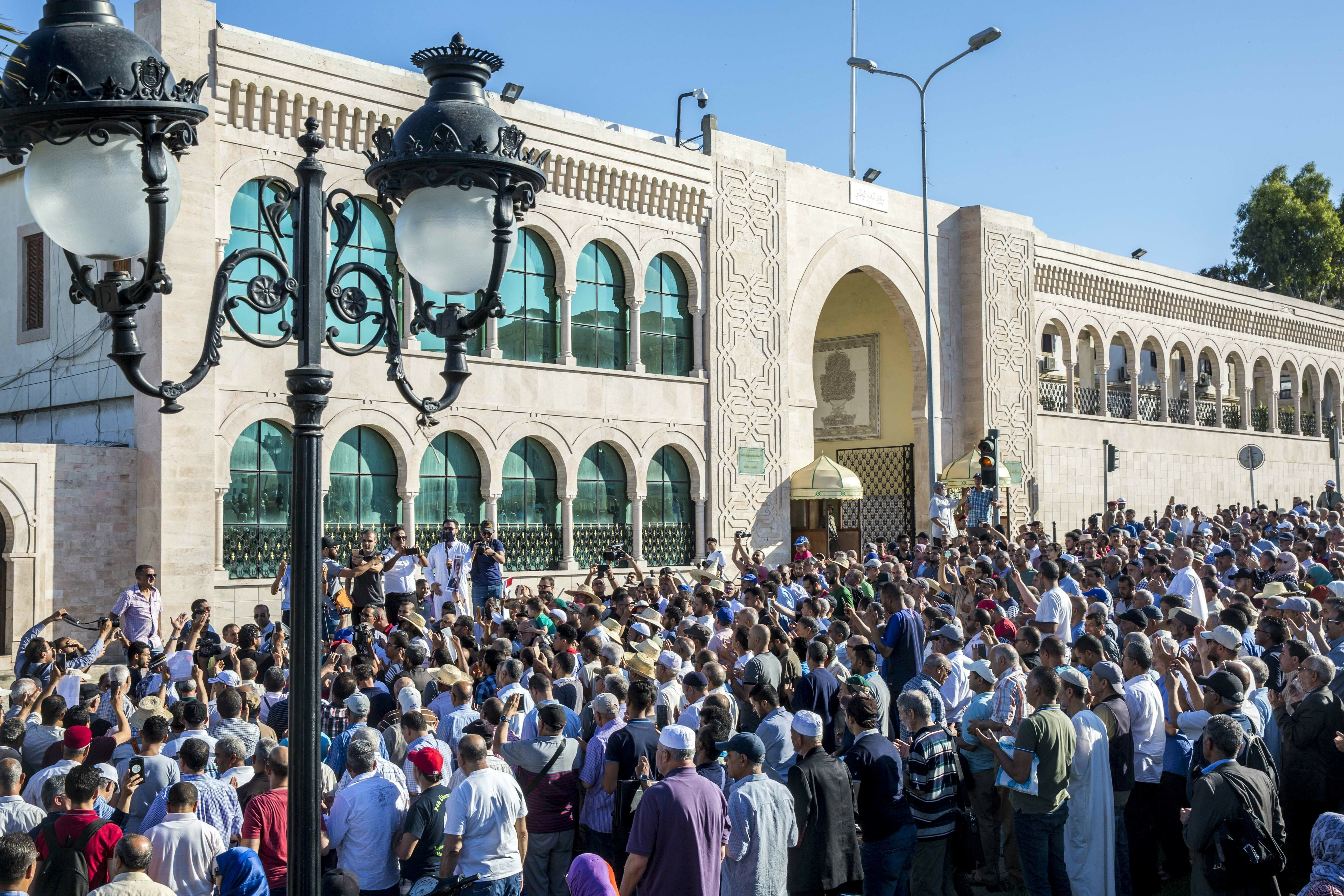 People chant slogans for ousted former Egyptian President Mohammed Morsi in Tunis, Tunisia. Tuesday, June 18, 2019. The former president, who was ousted by current President Abdel-Fattah el-Sissi in a military coup in 2013, collapsed in a courtroom in Egypt during trial on Monday and died. (AP Photo/Hassene Dridi)