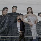 The Latest: SKorean economy shrinks for 1st time in 22 years