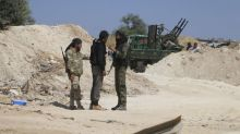 Tale of two brothers reflects Syrian rebel unity and divisions